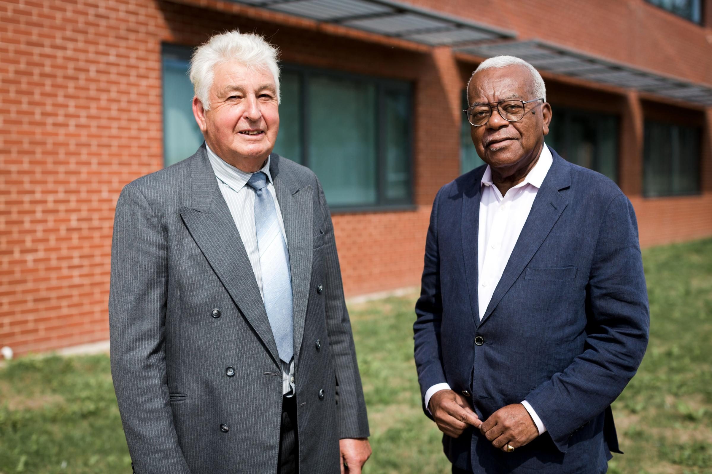 Retired detective Stuart Clifton and Sir Trevor McDonald
