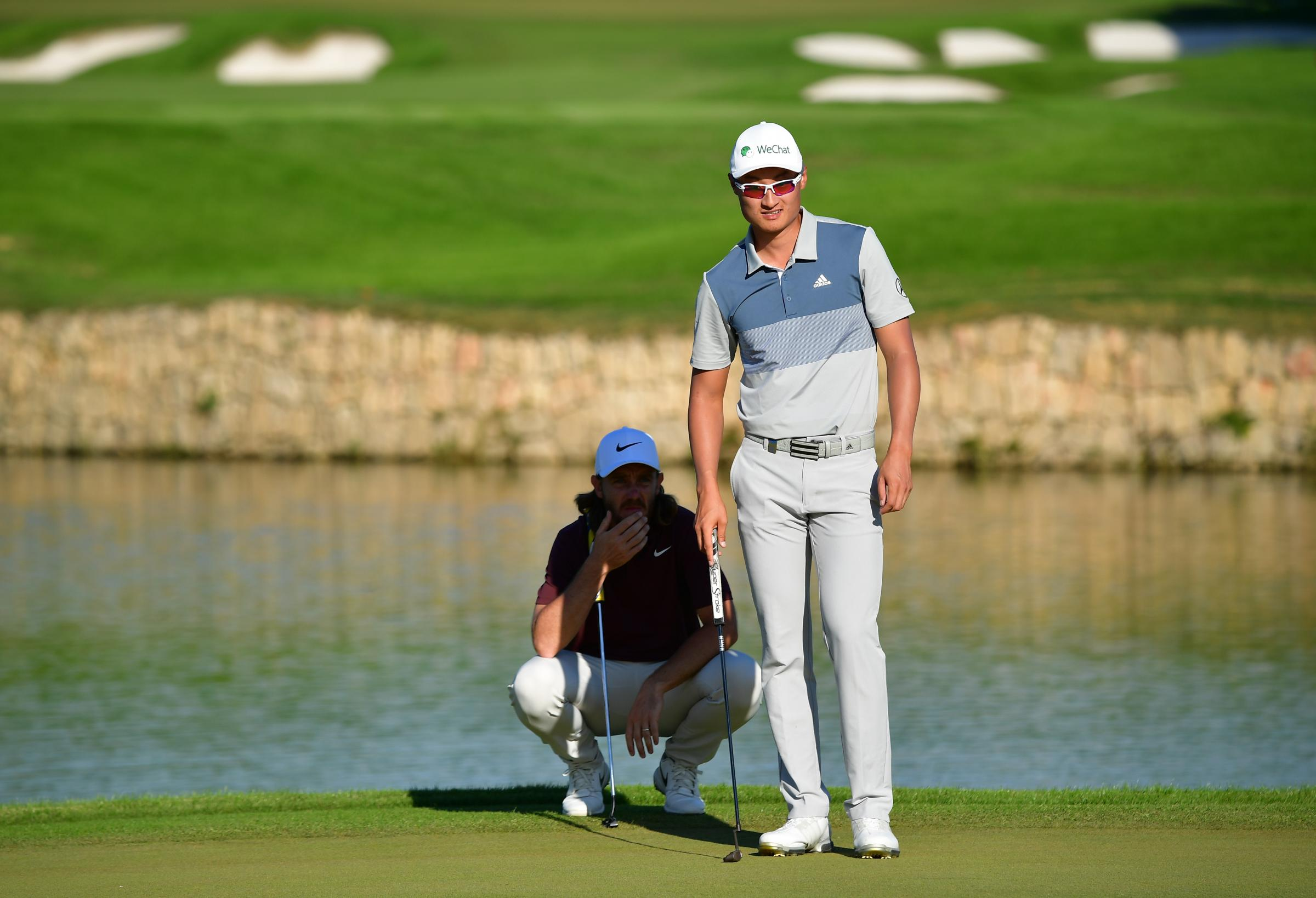 ANTALYA, TURKEY - NOVEMBER 03:  Tommy Fleetwood of England and Haotong Li of China look on during the third round of the Turkish Airlines Open on November 3, 2018 in Antalya, Turkey.  (Photo by Stuart Franklin/Getty Images).