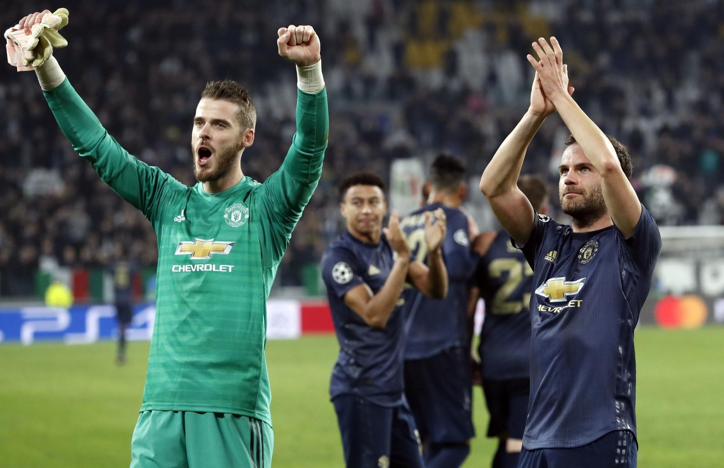 ManU goalkeeper David de Gea, left, and Juan Mata celebrate at the end of the Champions League group H soccer match between Juventus and Manchester United at the Allianz stadium in Turin, Italy, Wednesday, Nov. 7, 2018. Manchester won 2-1. (AP Photo/Anton