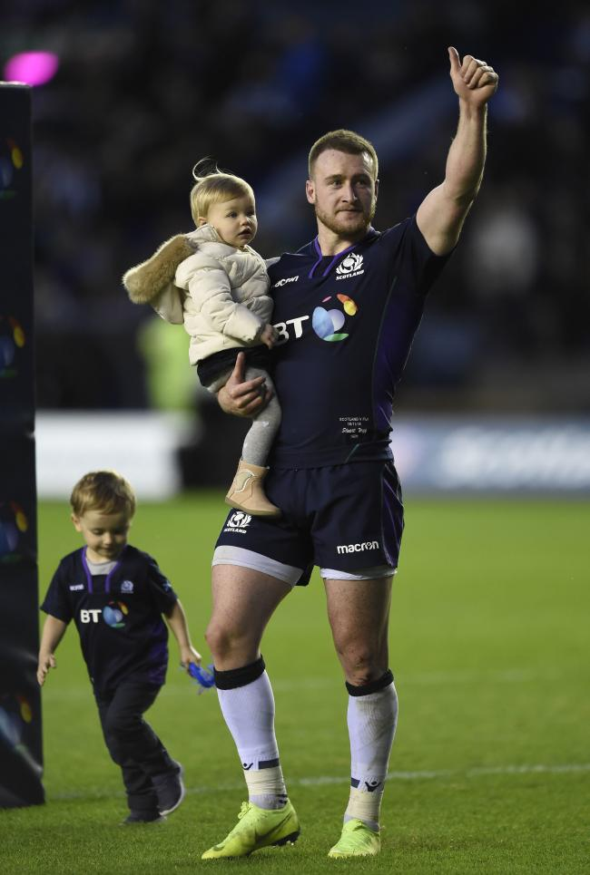 Stuart Hogg of Scotland with his family salutes the fans after the Autumn International match at BT Murrayfield Stadium, Edinburgh. PRESS ASSOCIATION Photo. Picture date: Saturday November 10, 2018. See PA story RUGBYU Scotland. Photo credit
