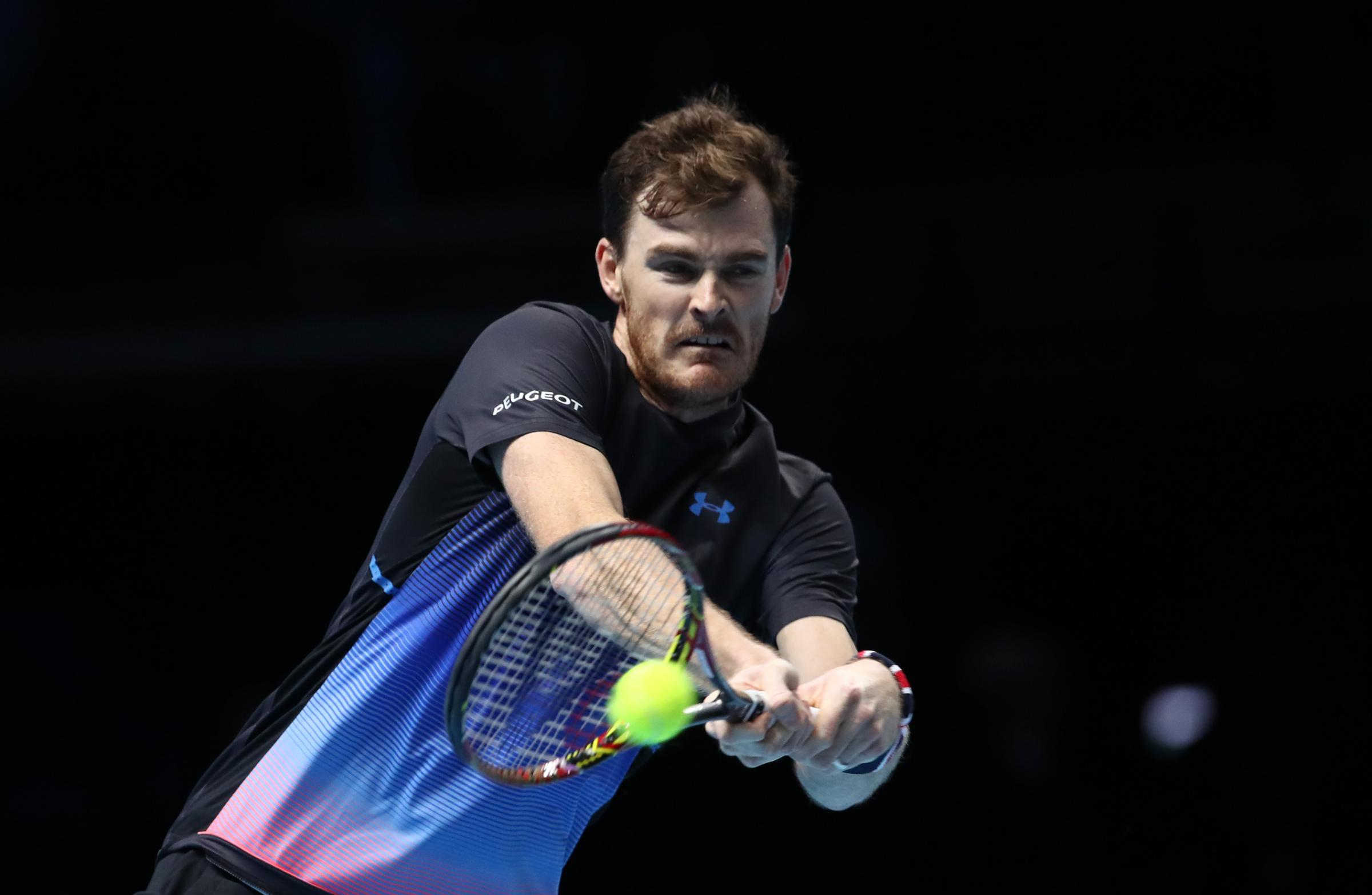 LONDON, ENGLAND - NOVEMBER 17: Jamie Murray of Great Britain plays a backhand shot in his doubles semi finals match against Mike Bryan and Jack Sock of The United States during Day Seven of the Nitto ATP Finals at The O2 Arena on November 17, 2018 in Lond