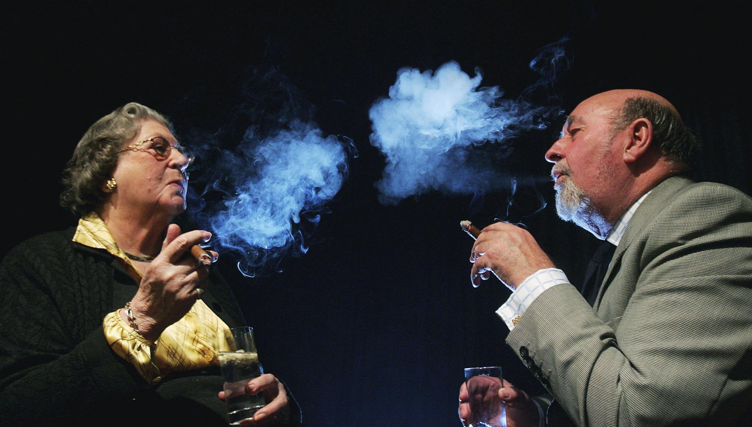 Baroness Trumpington and Lord Pendry have a cigar on National No Smoking Day in 2006.