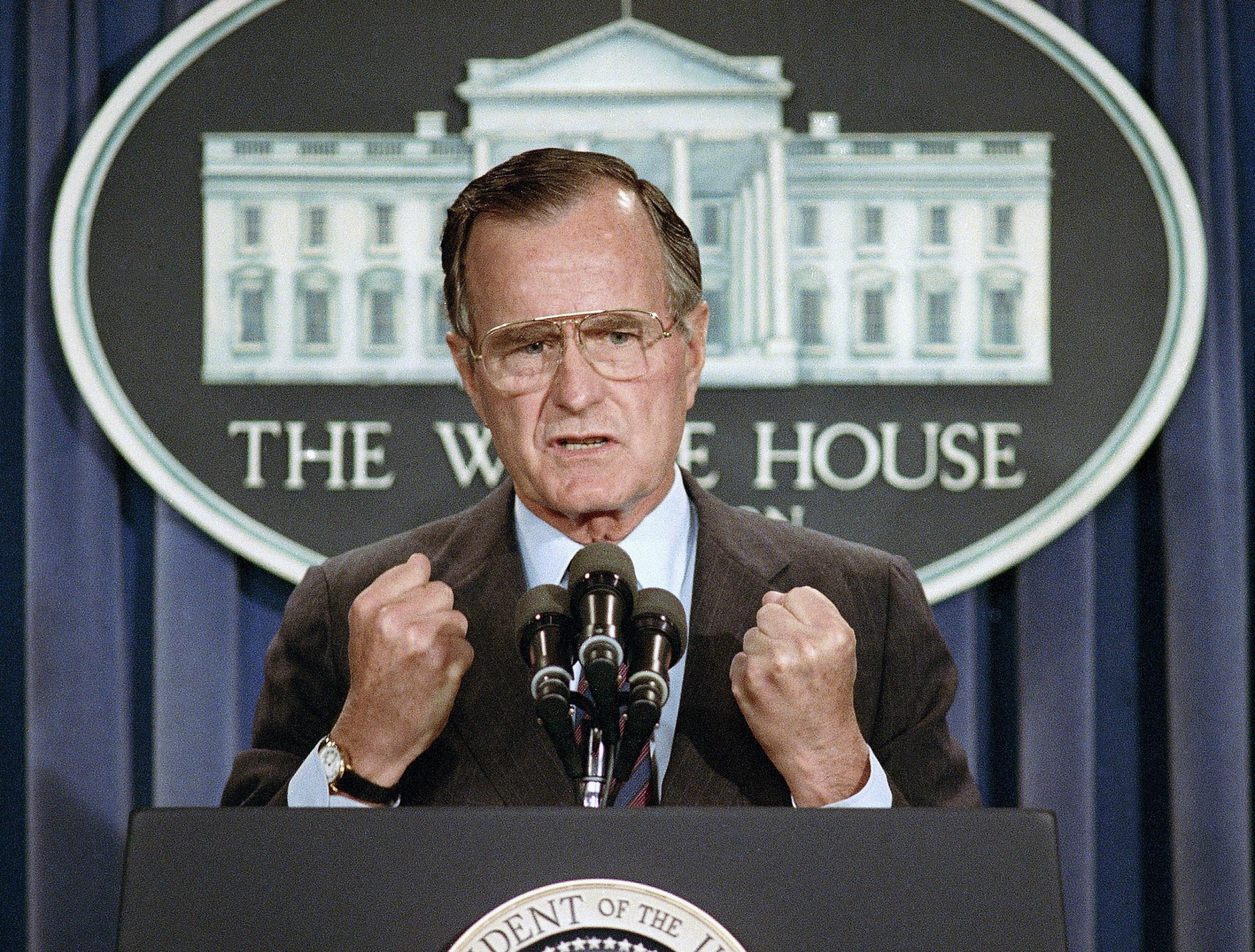 FILE - In this June 5, 1989 file photo, U.S. President George H.W. Bush holds a news conference at the White House in Washington where he condemned the Chinese crackdown on pro-democracy demonstrators in Beijing's Tiananmen Square. Bush died at the a