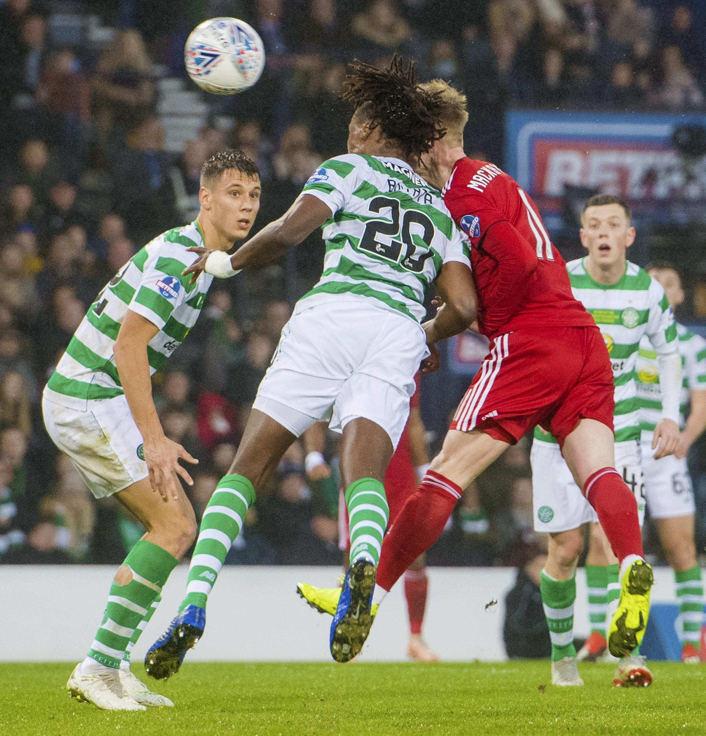 Celtic's Dedryck Boyata and Aberdeen's Gary Mackay-Steven suffer a nasty clash of heads