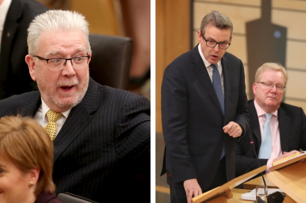 Brexit Secretary Mike Russell, left, and Adam Tomkins, constitution spokesman for the Scottish Conservatives, clashed during the debate. Picture: PA.