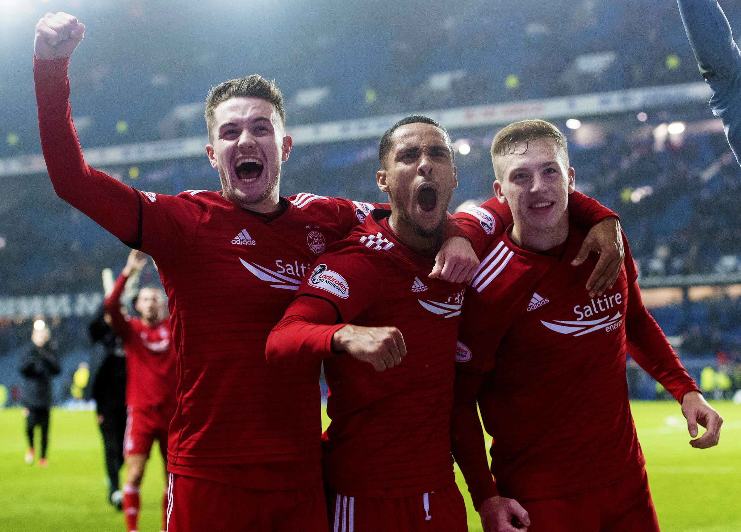 05/12/18 LADBROKES PREMIERSHIP.RANGERS v ABERDEEN (0-1).IBROX - GLASGOW.Aberdeen's Scott Wright, Max Lowe and Lewis Ferguson celebrate at full time.