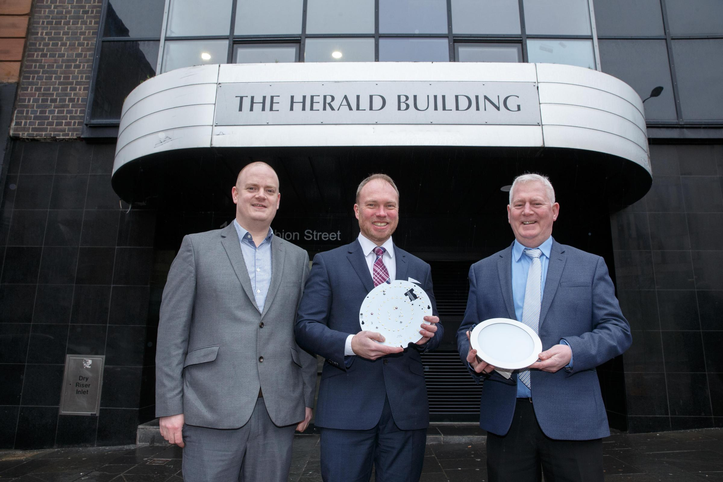 Pictured left to right, The Herald's Stephen McTaggart, Joint Newton Property Management MD, Derek MacDonald, and property manager, Tom McCusker, are pictured with the new lights outside the Herald Building in Albion Street, Glasgow