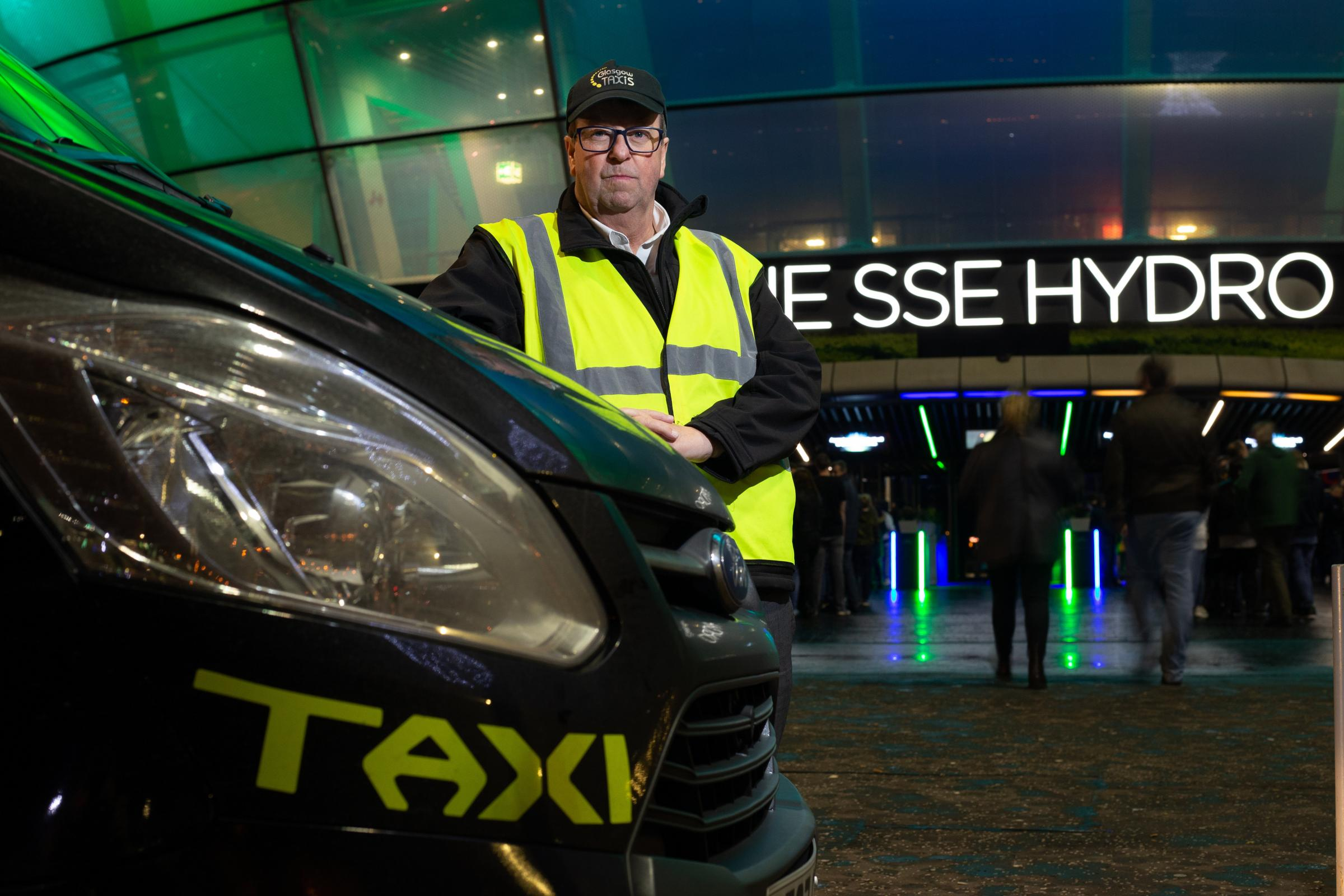 Taxi marshal Martin Garrity pictured at the taxi rank outside the SSE Hydro in Glasgow