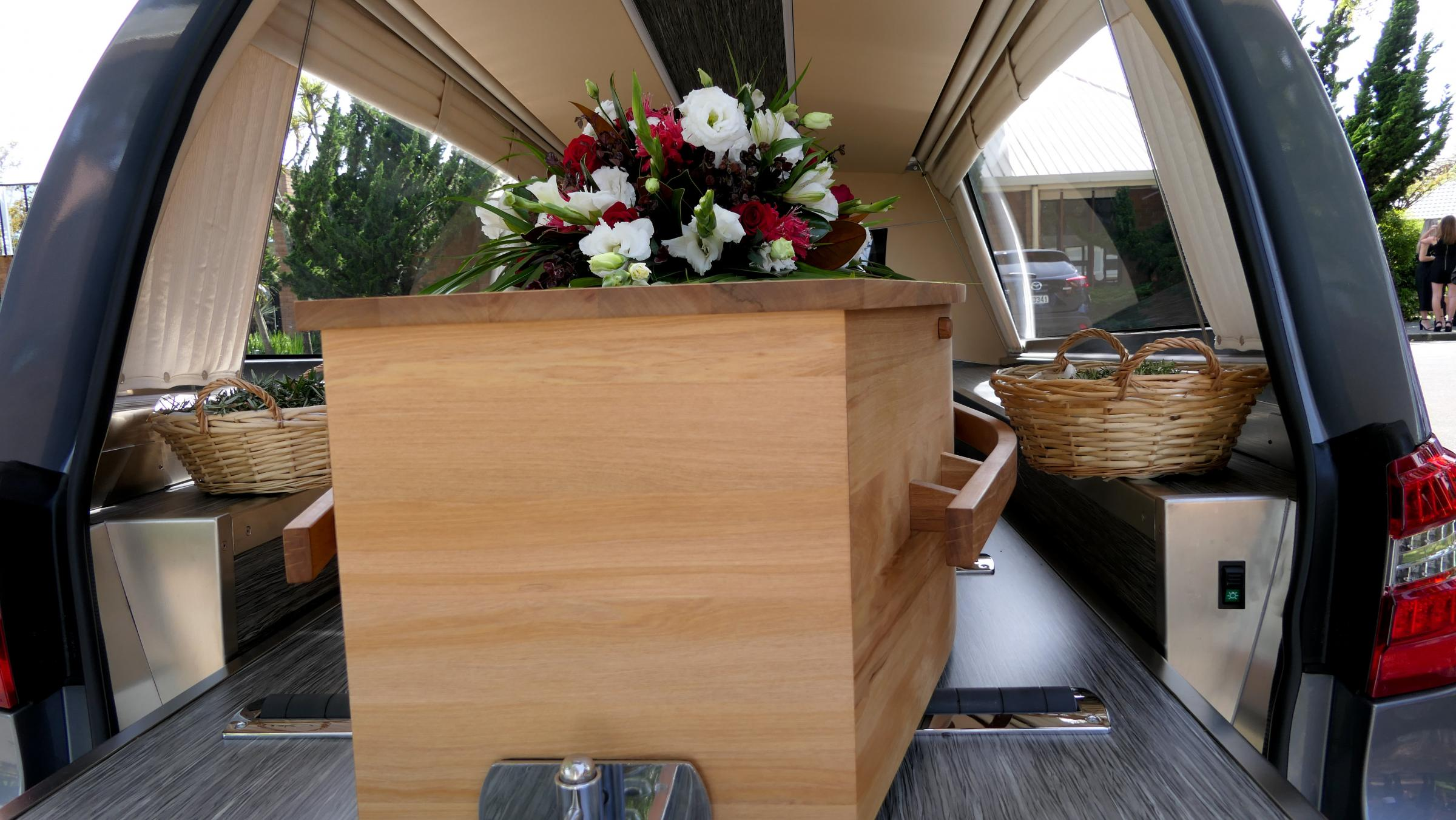 closeup shot of a colorful casket in a hearse or chapel before funeral or burial at cemetery.; Shutterstock ID 1062486785.