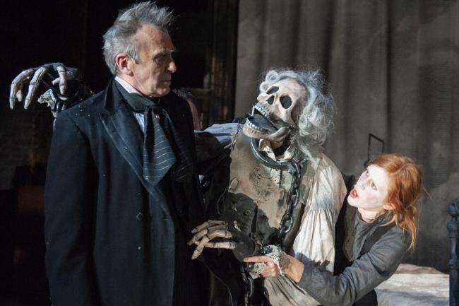 Benny Young (Scrooge) and Elise De Grey (ensemble) in A Christmas Carol. Photograph: Tim Morozzo