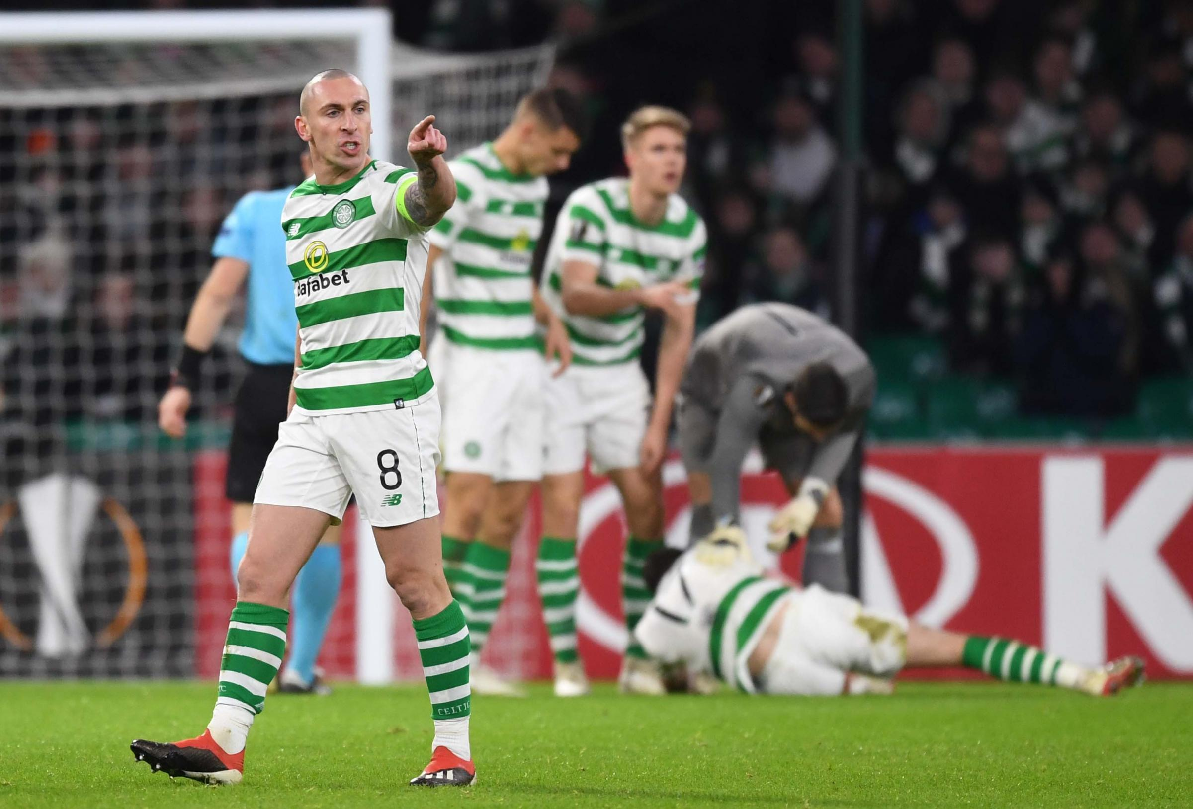 Scott Brown takes charge as he issues instructions while Ryan Christie receives treatment against RB Salzburg