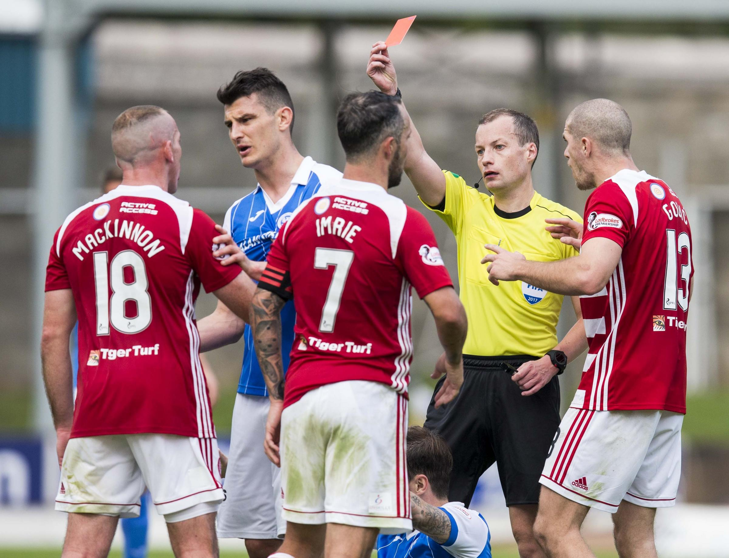 Referee Willie Collum shows Darian MacKinnon a red card, but the Hamilton captain has some sympathy for the match officials