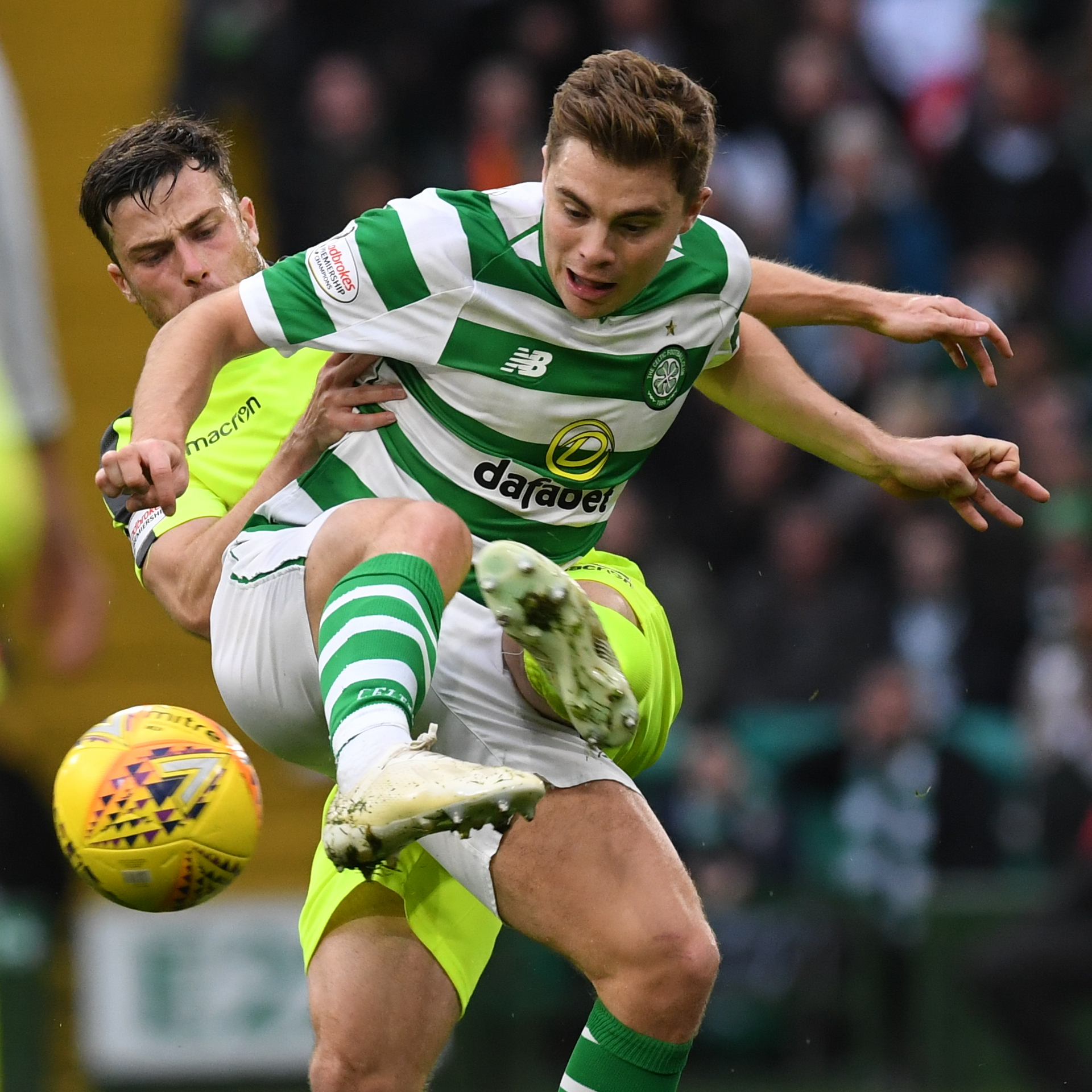 Celtic's James Forrest (right) holds off Lewis Stevenson during their last encounter in October
