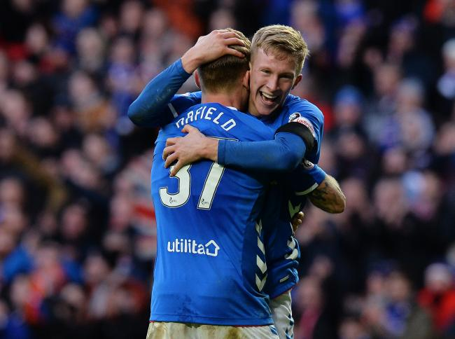 GLASGOW, SCOTLAND - DECEMBER 29: Ross McCrorie and Scott Arfield of Rangers celebrates at the final whistle as Rangers beat Celtic 1-0 during the Ladbrokes Scottish Premiership match between Rangers and Celtic at Ibrox Stadium on December 29, 2018 in Glas
