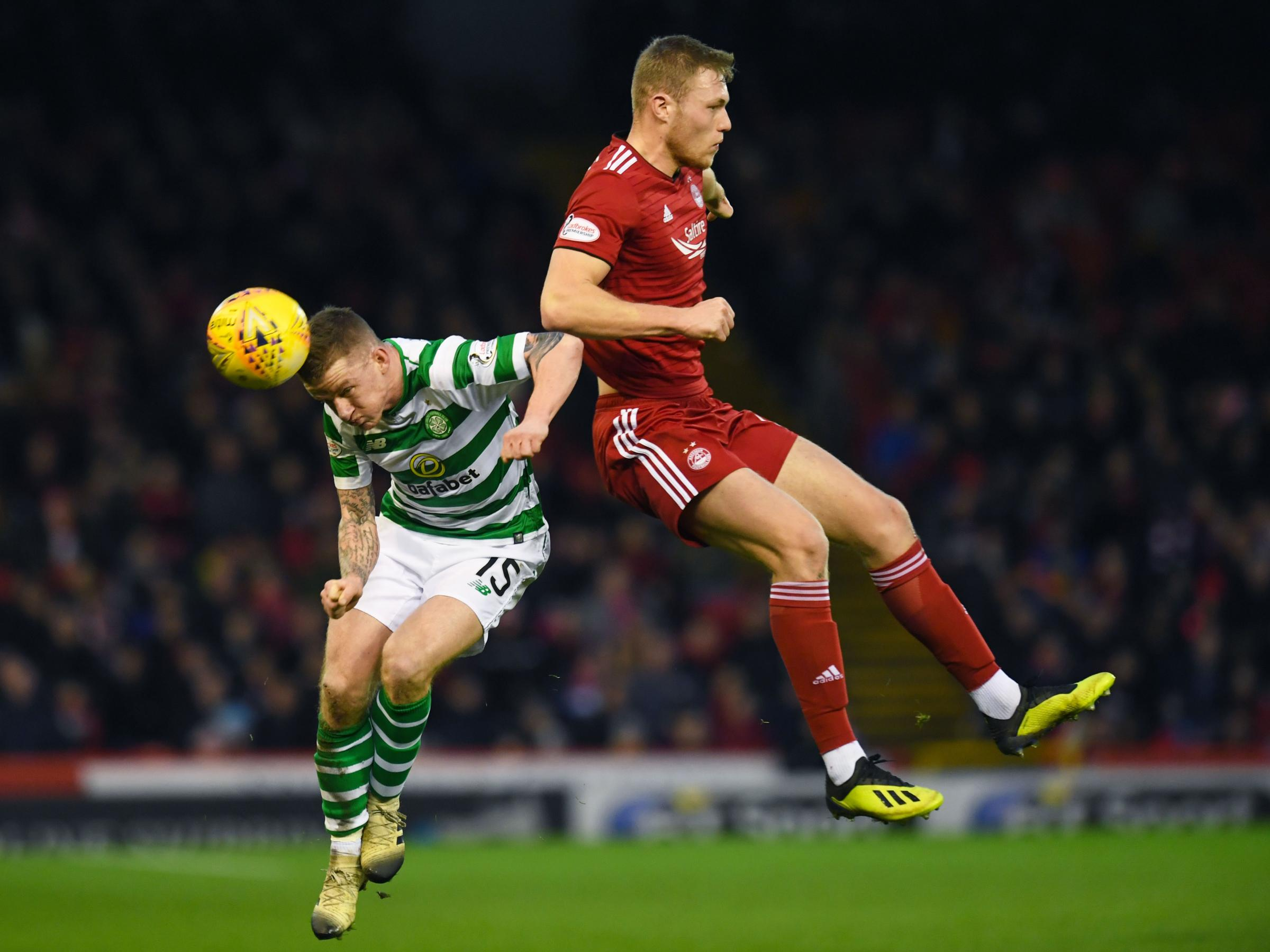 26/12/18 LADBROKES PREMIERSHIP.ABERDEEN v CELTIC.PITTODRIE - ABERDEEN.Celtic's Jonny Hayes (L) with Aberdeen's Sam Cosgrove..