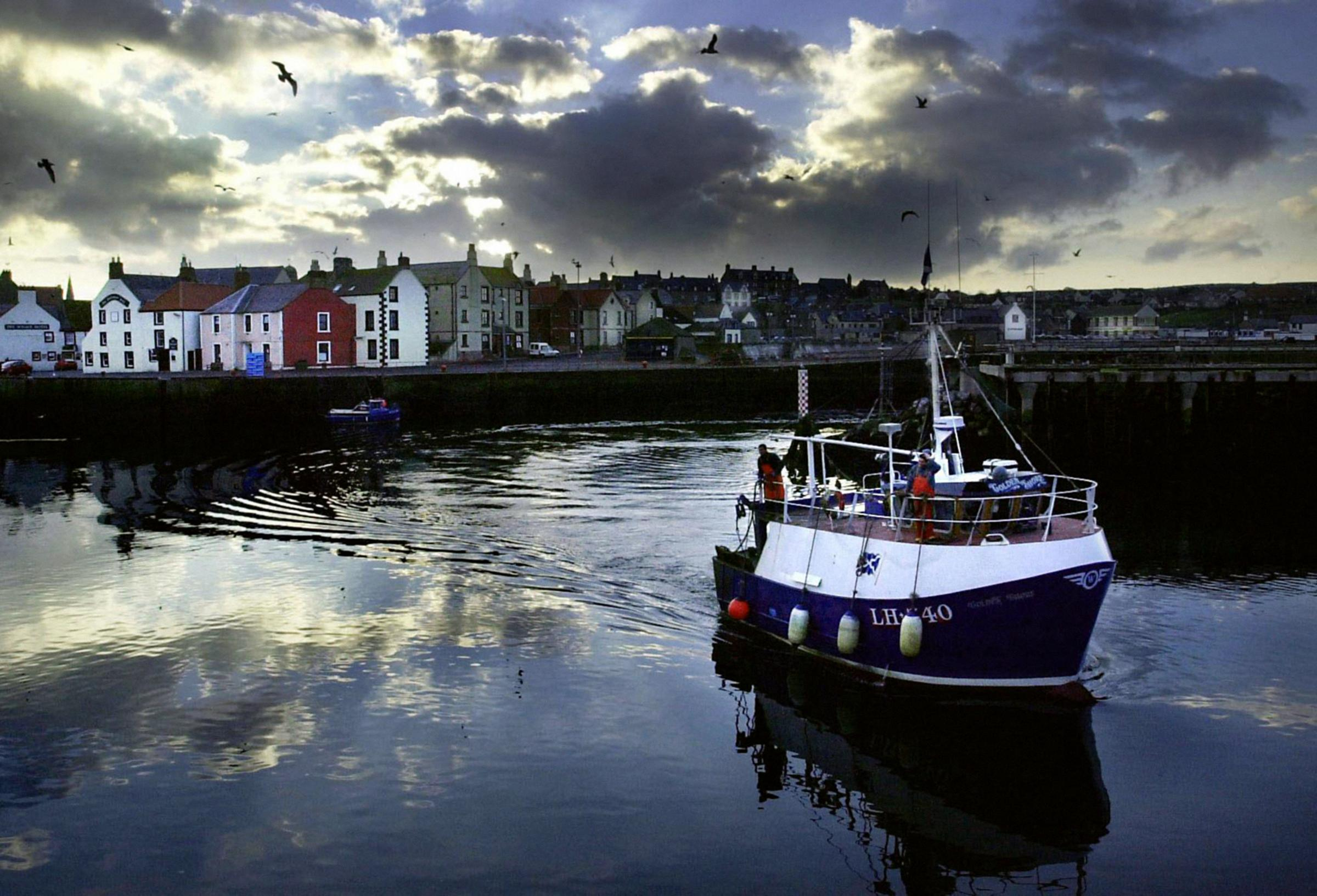 A trawler at Eyemouth harbour, in the Scottish borders. Photo: David Cheskin/PA Wire