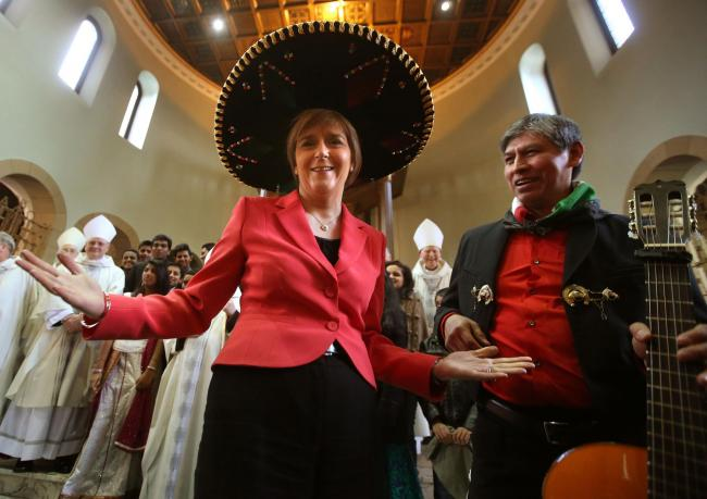 First Minister Nicola Sturgeon tries on a Sombrero next to Luis Garcia from Mexico as she attends the  National Mass at  St Columbkilles RC Church in Glasgow to celebrate the 50th anniversary of the Scottish Catholic International Aid Fund and to  mark th
