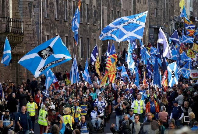 Pro-independence supporters march through Edinburgh, during the All Under One Banner march. PRESS ASSOCIATION Photo. Picture date: Saturday October 6, 2018. Photo credit should read: Jane Barlow/PA Wire.