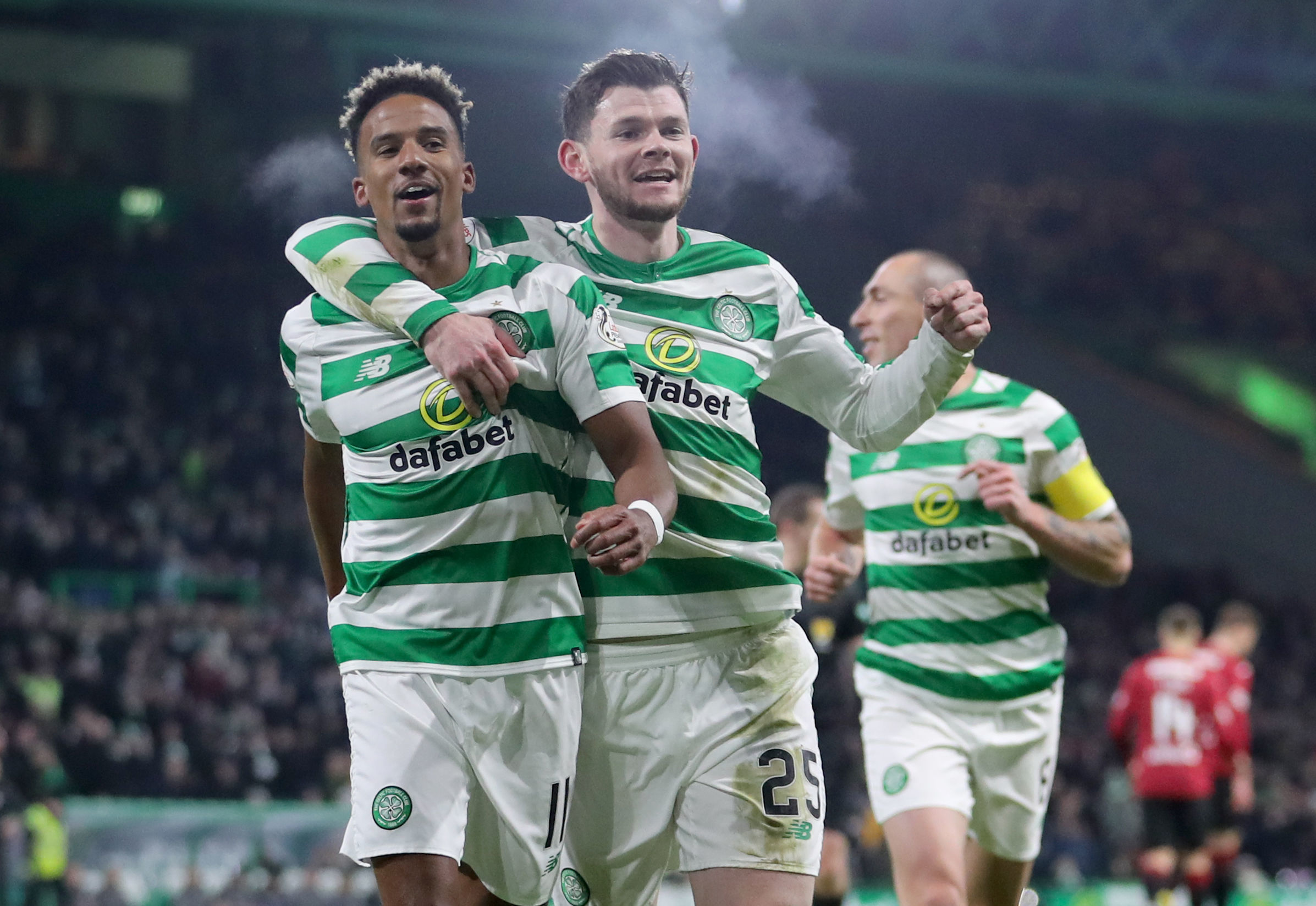 Celtic's Scott Sinclair celebrates scoring his sides second goal from a penalty with Oliver Burke (right) during the Ladbrokes Scottish Premiership match at Celtic Park, Glasgow. PRESS ASSOCIATION Photo. Picture date: Wednesday January 23, 2019. See P