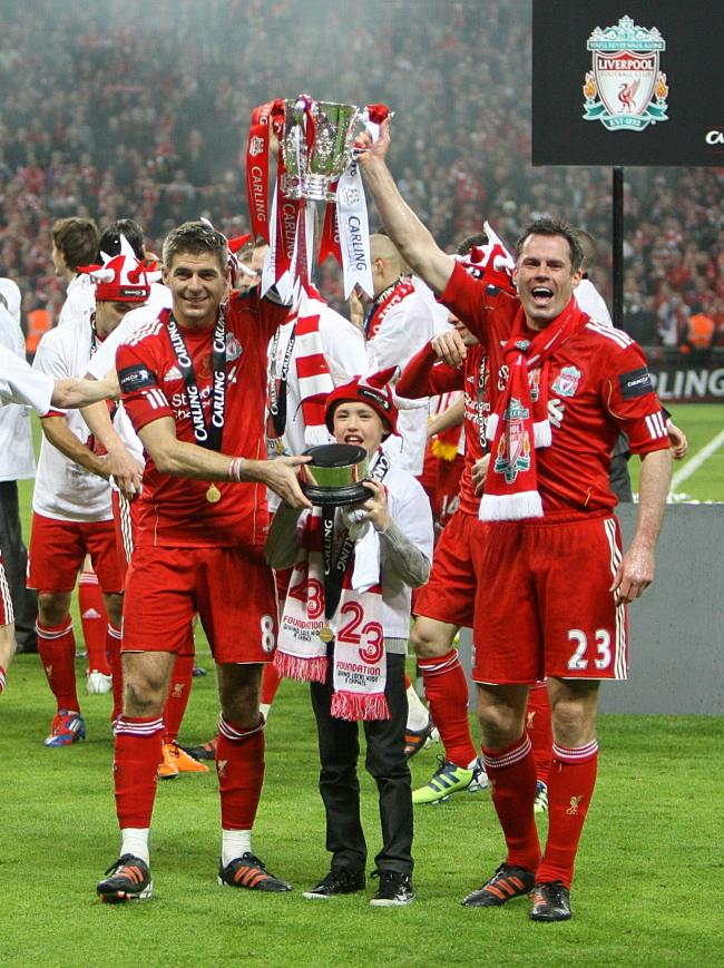 222a57603cf File photo dated 26-02-2012 of Liverpool s Jamie Carragher and Steven  Gerrard celebrating