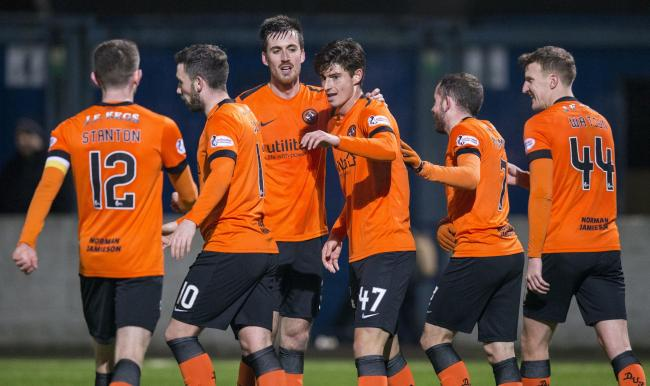 Dundee United's Ian Harkes scores the fourth goal for his side