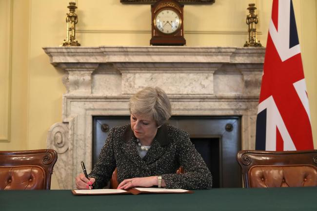 Theresa May signing the Article 50 letter