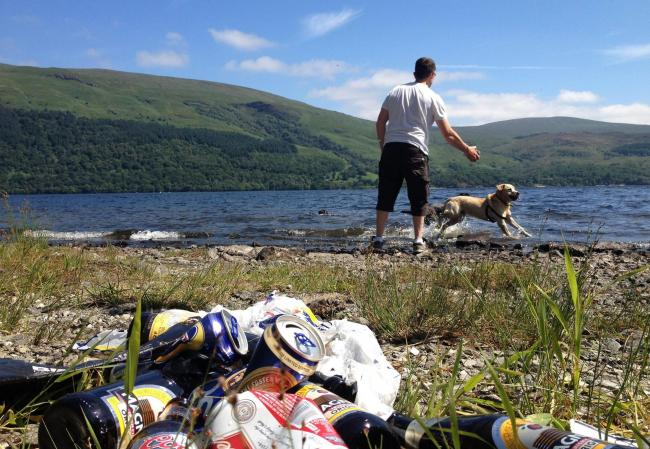 Litter disfigures a shoreline on Loch Lomond looking out to Ben Lomond