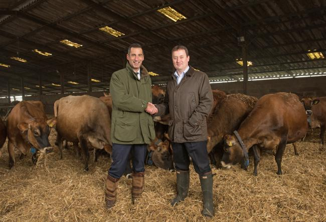 Group buying director of ALDI Scotland Graham Nicolson and Robert Graham of Graham's the Family Dairy on the farm near Stirling.