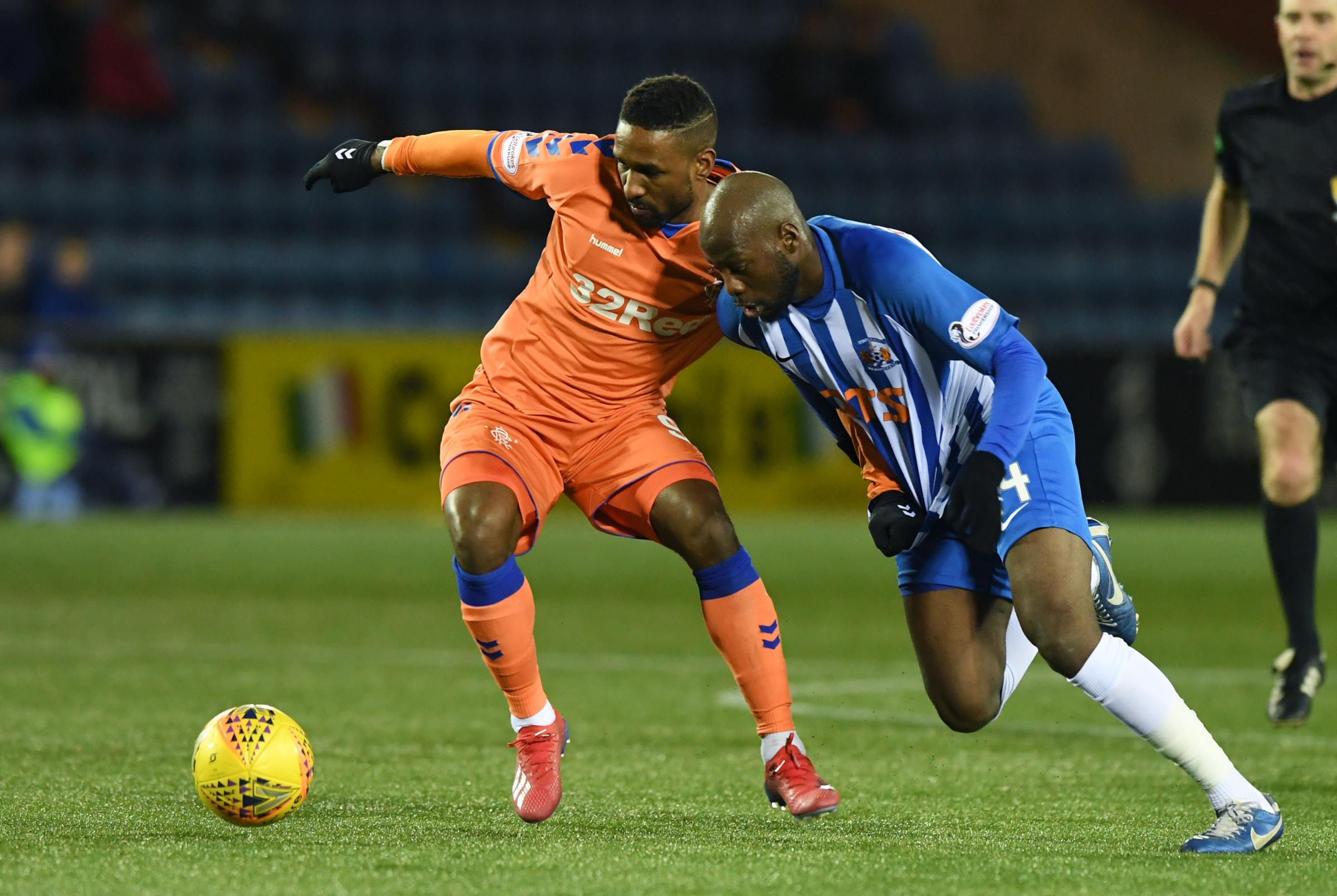 Kilmarnock midfielder Youssouf Mulumbu, right, challenges Rangers striker Jermain Defoe for the ball at Rugby Park on Saturday.