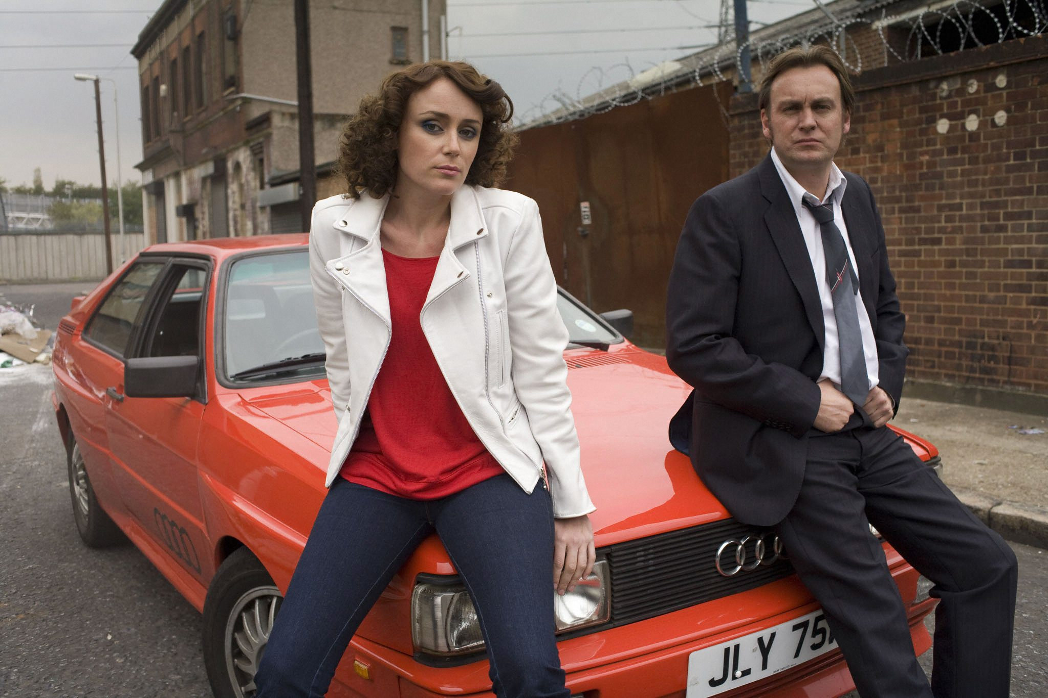 DI Alex Drake (Keeley Hawes) and DCI Gene Hunt (Philip Glenister) in crime drama Ashes to Ashes