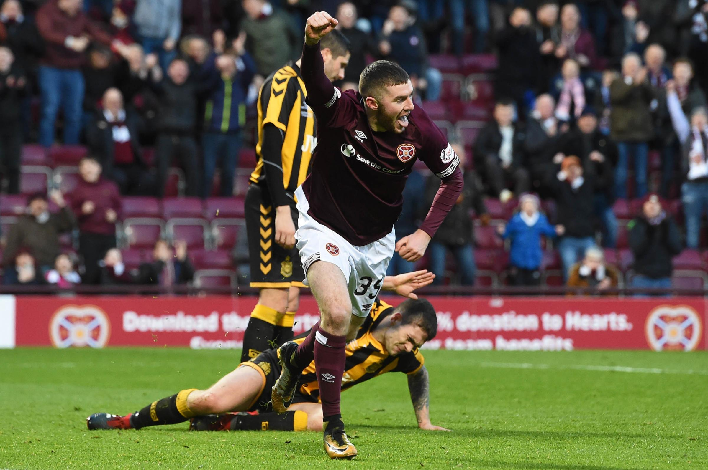 10/02/19 WILLIAM HILL SCOTTISH CUP 5TH ROUND.HEARTS v AUCHINLECK TALBOT.TYNECASTLE PARK - EDINBURGH.Aidan Kenna wheels away in delight after making it 4-0 to Hearts'..