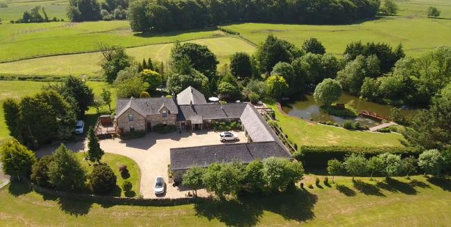 Beautiful grounds complete with a pond and small island make Castlehill Farm perfect for relaxing