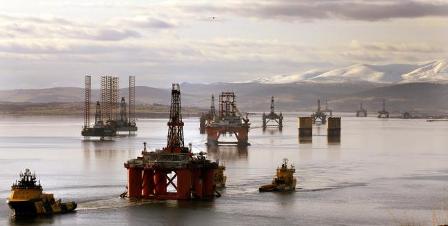 The oil platform Stena Spey (bottom left) is moved with tug boats amongst other rigs in the Cromarty Firth near Invergordon in the Highlands of Scotland. PRESS ASSOCIATION Photo. Picture date: Monday February 15, 2016. The sheltered waters of Cromarty Fir