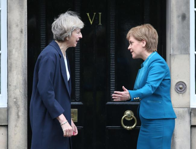 Prime Minister Theresa May (left) is greeted by Scotland's First Minister Nicola Sturgeon at Bute House in Edinburgh. PRESS ASSOCIATION Photo. Picture date: Friday July 15, 2016. See PA story POLITICS Conservatives. Photo credit should read: Andrew Mi