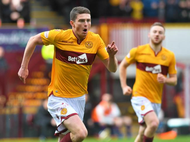 Jake Hastie celebrates his opener for Motherwell against Hearts.