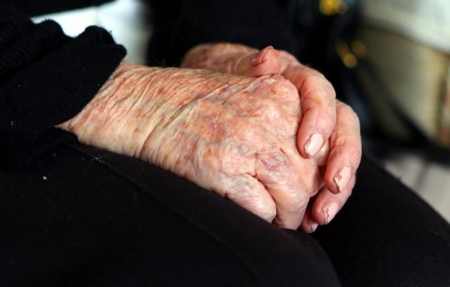 Embargoed to 1800 Wednesday August 31.File photo dated 7/10/2013 of the hands of an elderly woman at home. A long-awaited drug treatment which can halt Alzheimer's disease may be on the horizon after promising results from an early stage clinical tria