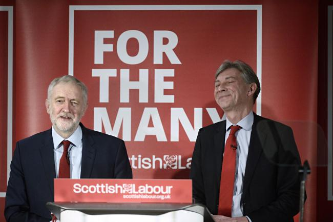 GLASGOW, SCOTLAND - NOVEMBER 27: UK Labour Leader Jeremy Corbyn (left) and Scottish Labour Leader Richard Leonard (right) address party activists as they set out their vision for the county with at an event at the Lighthouse on November 27, 2017 in Glasgo