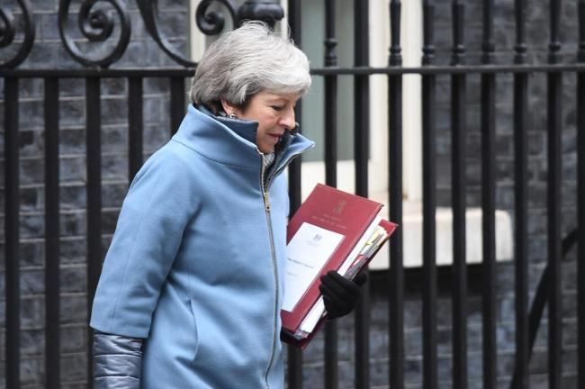 Theresa May pictured outside 10 Downing Street yesterday