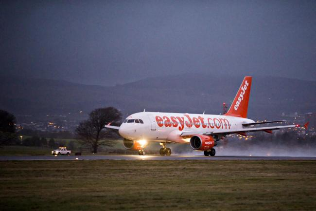 PAISLEY, SCOTLAND - DECEMBER 01: an easyJet airbus aircraft takes off from Glasgow airport runway on December 01, 2015 in Paisley, Scotland. Shot as part of a behind the scenes feature by Peter Swindon for the Evening Times (Photo by Jamie Simpson/Herald