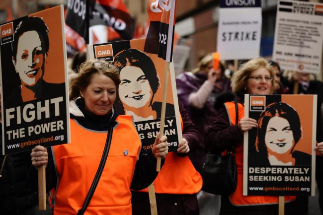 GLASGOW, SCOTLAND - OCTOBER 23: around 8000 women employed by Glasgow City Council march from Glasgow Green to the City Chambers as part of strike action over historic equal pay claims against the authority on October 23, 2018 in Glasgow, Scotland. About