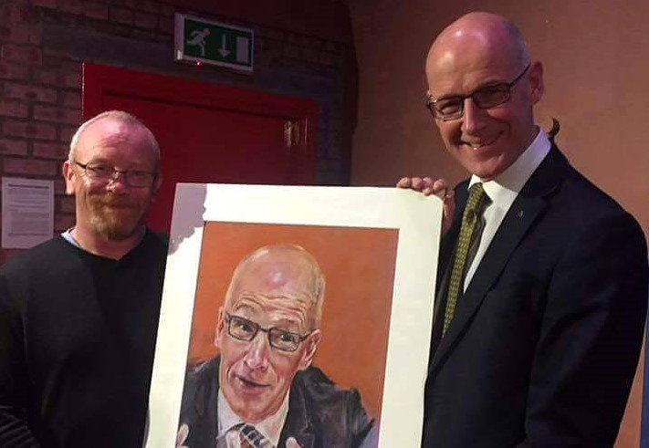 John was delighted to present John Swinney with a portrait he had made. Credit: UGC
