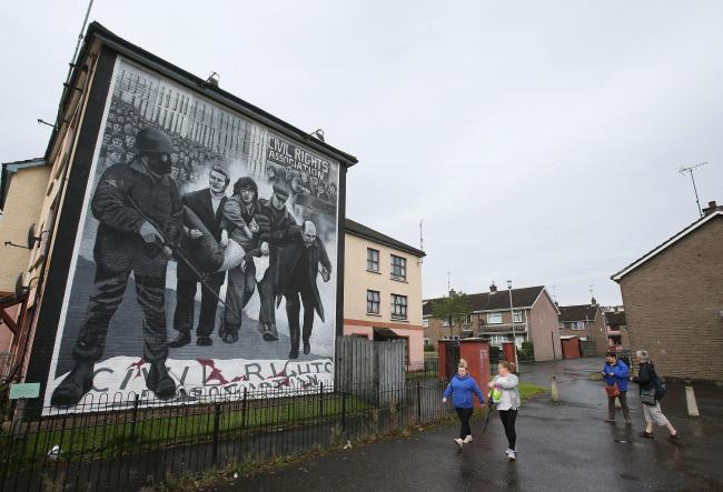 File photo dated 9/8/2016 of a mural in the Bogside area of Derry depicting Dr Edward Daly waving a blood-soaked handkerchief as he led fatally injured civil rights protestor Jackie Duddy away from gunfire on Bloody Sunday in January 1972.  The Public Pro