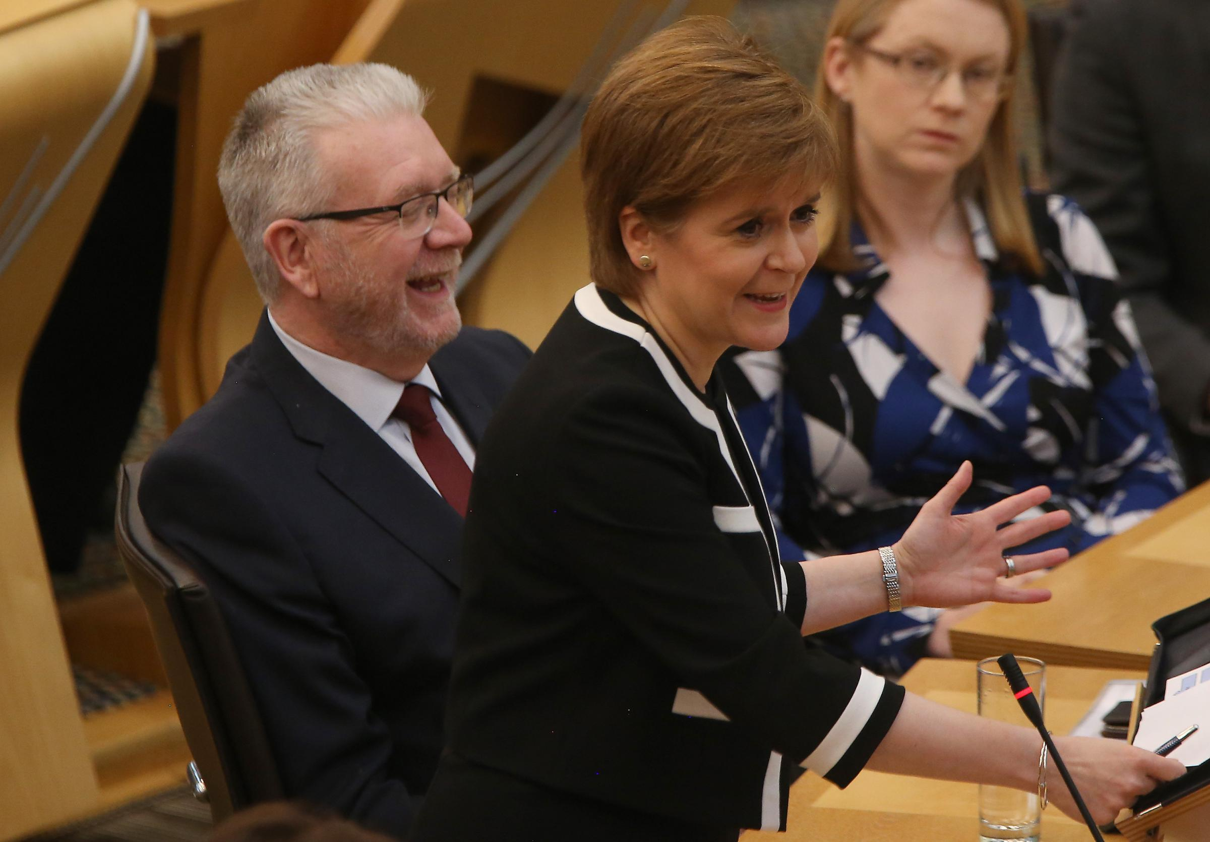 Nicola Sturgeon and her Brexit Secretary Mike Russell at FMQs at Holyrood thursday. STY.Pic Gordon Terris/The Herald.14/9/19.
