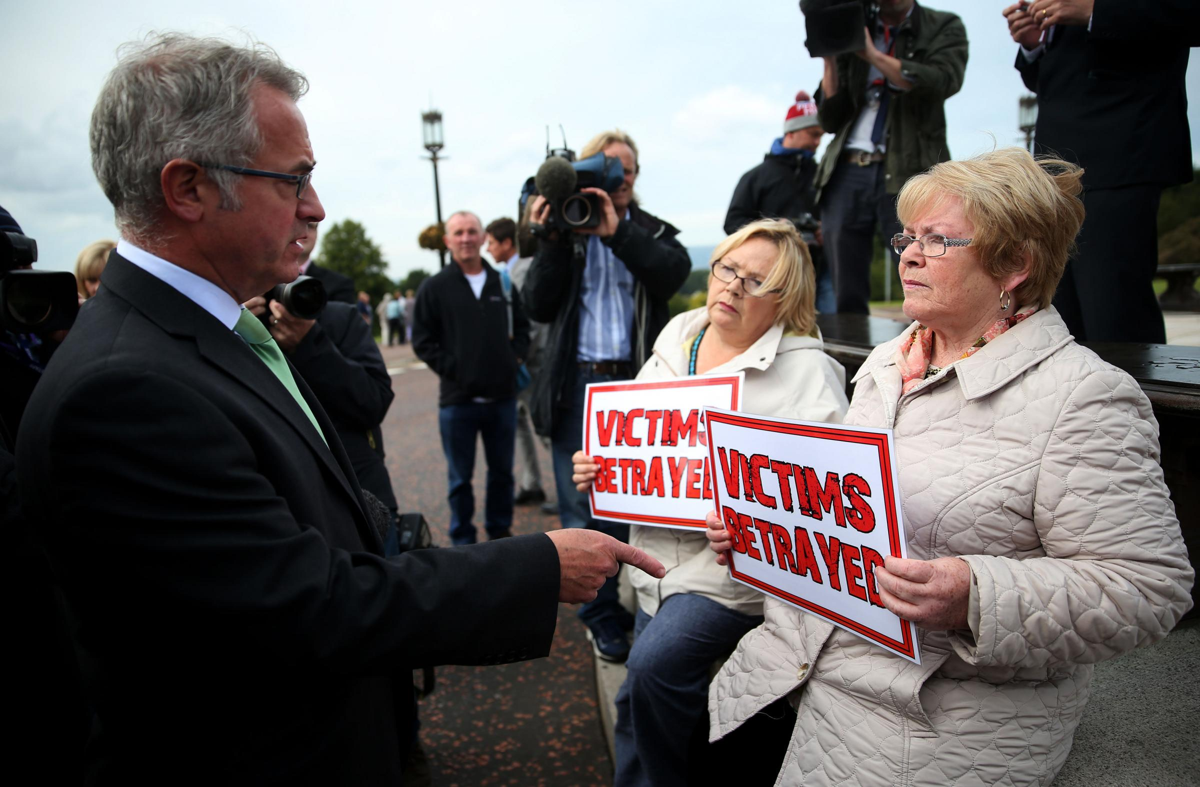 File photo dated 14/09/2015 of SDLP's Alex Attwood (left) speaking to Kate Nash (right), whose brother William was killed by British soldiers on Bloody Sunday in 1972, she has welcomed the development of a former British soldier being questioned by de