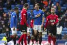 Kilmarnock's Kirk Broadfoot (left) exchanges words with Nikola Katic