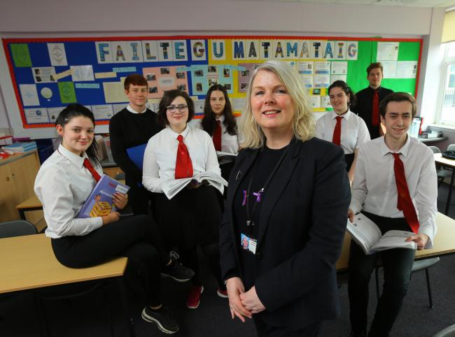 Dr Donalda McComb, headteacher of the Glasgow Gaelic School, with year six pupils (Colin Mearns)