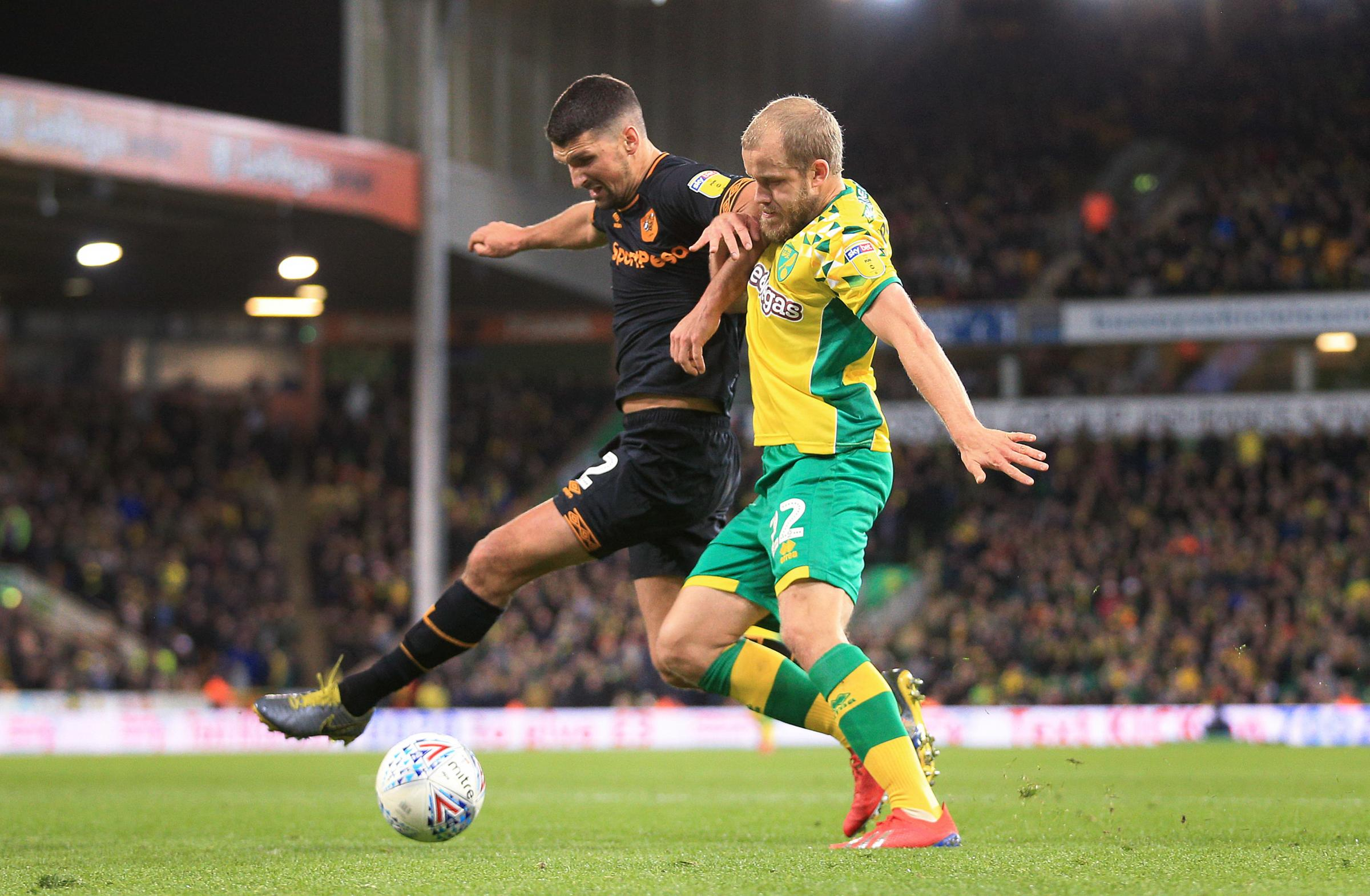 NORWICH, ENGLAND - MARCH 13: Eric Lichaj of Hull in action with Teemu Pukki of Norwich during the Sky Bet Championship match between Norwich City and Hull City at Carrow Road on March 13, 2019 in Norwich, England. (Photo by James Chance/Getty Images).