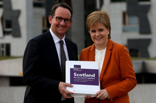 Andrew Wilson and Nicola Sturgeon with the Growth Commission report.