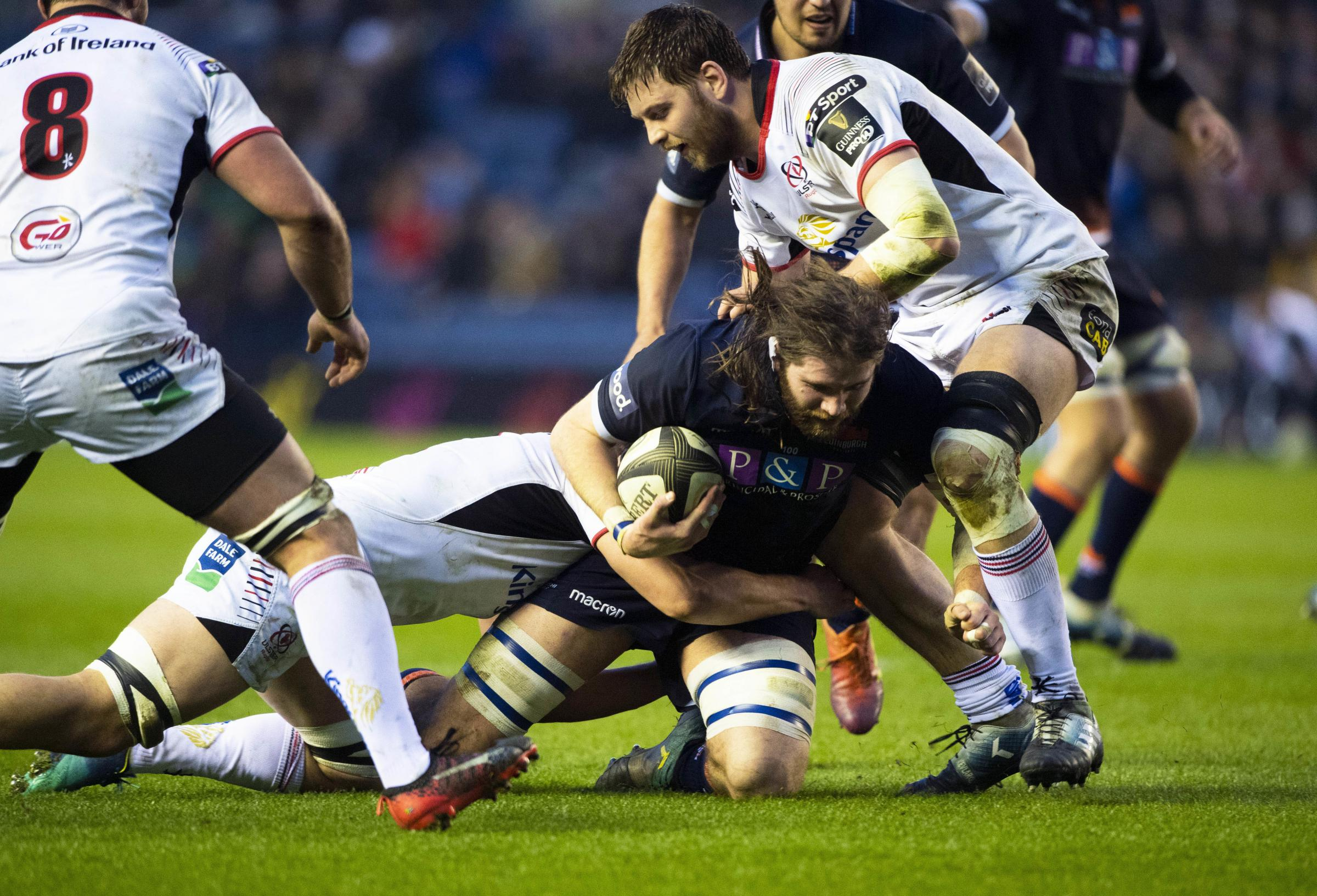 Edinburgh's Ben Toolis tries to drive forward under pressure from the Ulster defence