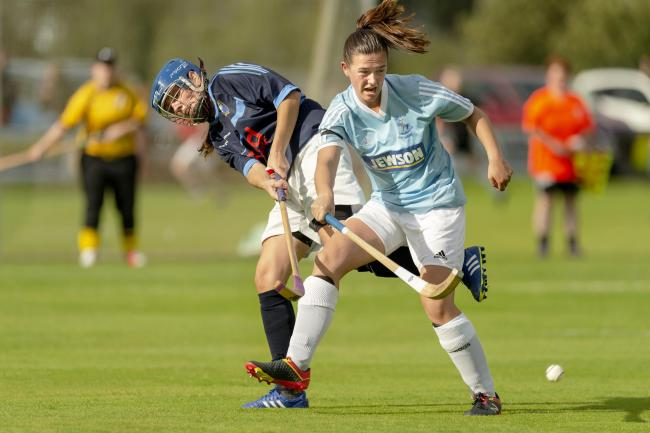 Sarah Caird (Badenoch) with Sarah Corrigall (Skye).  Skye v Badenoch and Strathspey in the WCA Valerie Fraser Camanachd Cup Final, played at The Dell, Kingussie.